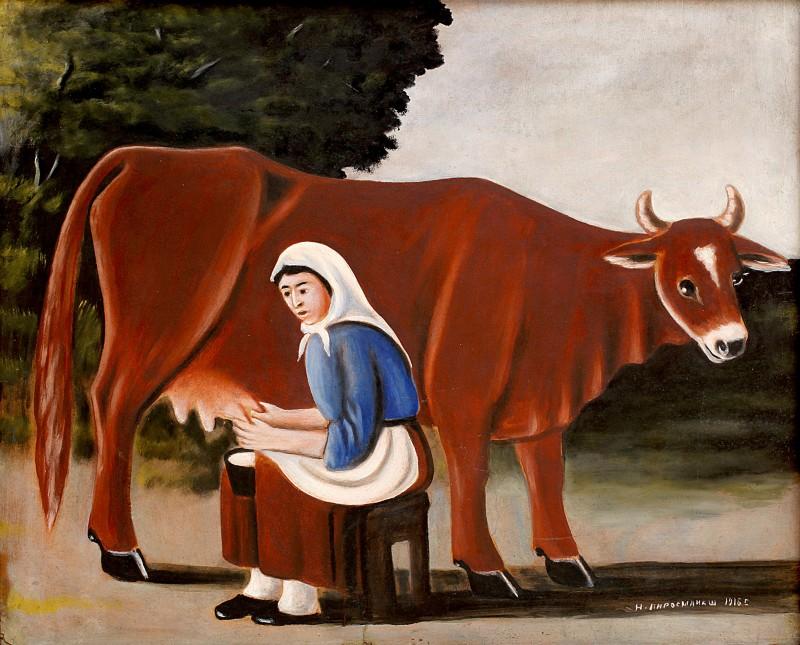 Woman milks a cow, 1916